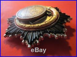 Médaille à identifier datée 1941 Pas casque allemand. DEUTSCHES KREUZ
